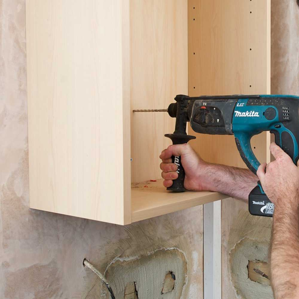 Axis operative using a drill to refit a cupboard
