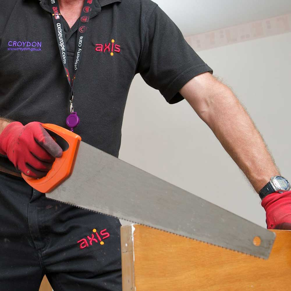Axis operative sawing a worksurface to fit inside a void property in Croydon