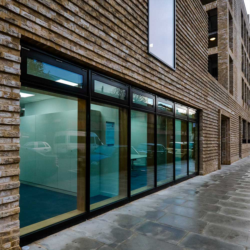 exterior-shot-of-silchester-hub-showing-the-brickwork-and-windows rainy day