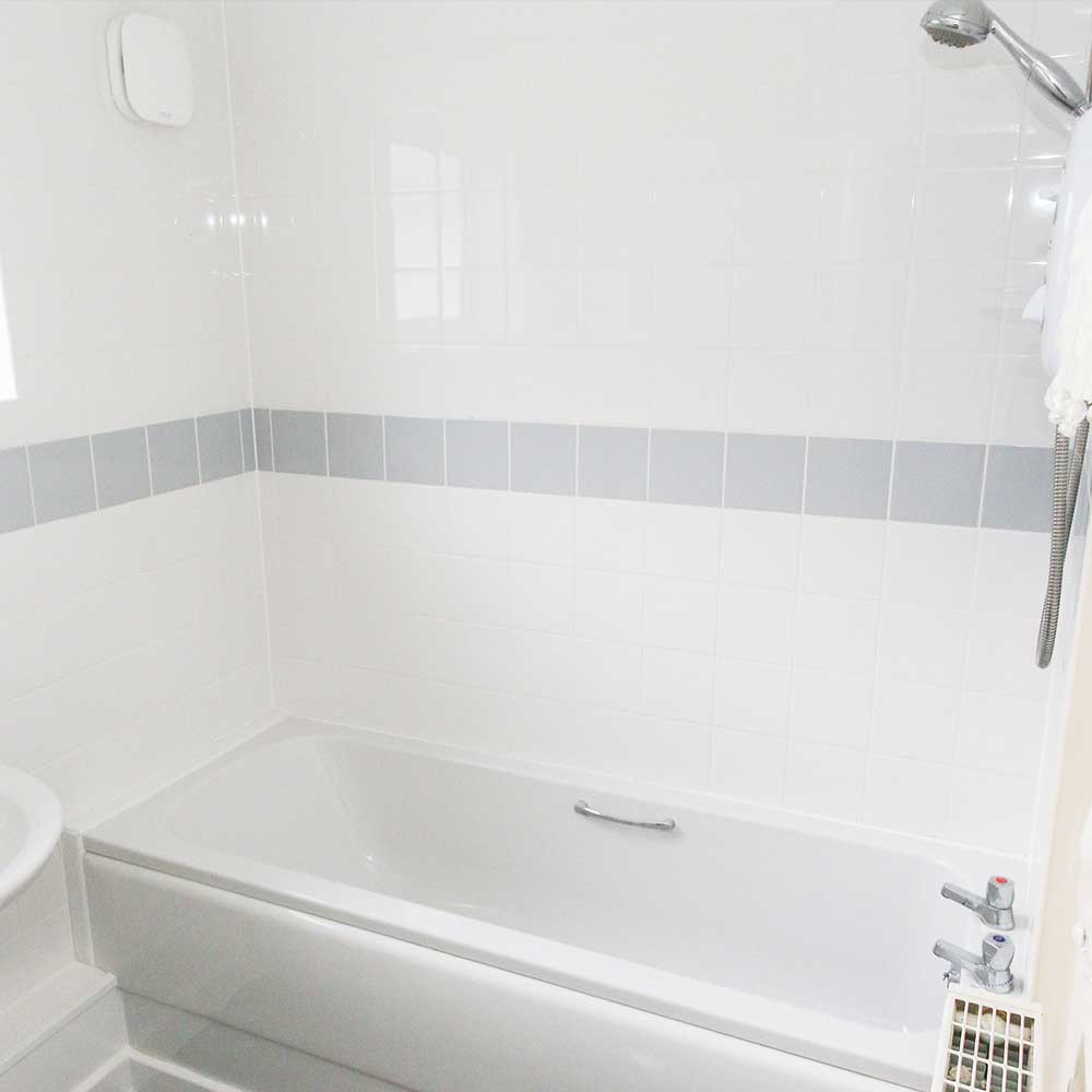 Bathroom and a shower inside a void property where axis undertook refurbishment works and services
