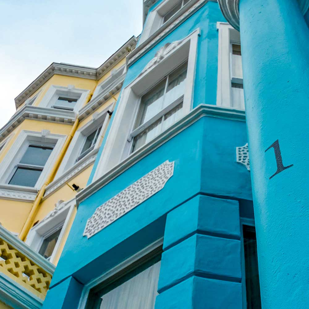 a vibrant blue painted porch on a property in notting hill