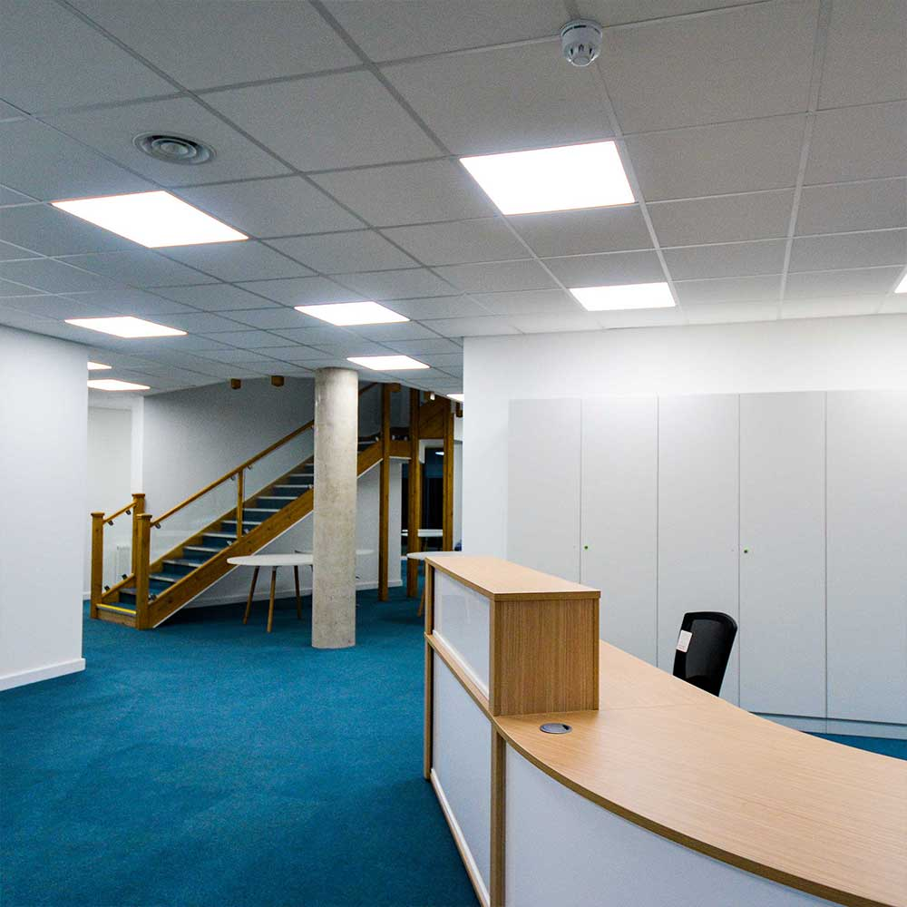 silchester-hub-desk-and-reception-with-staircase and lights installed