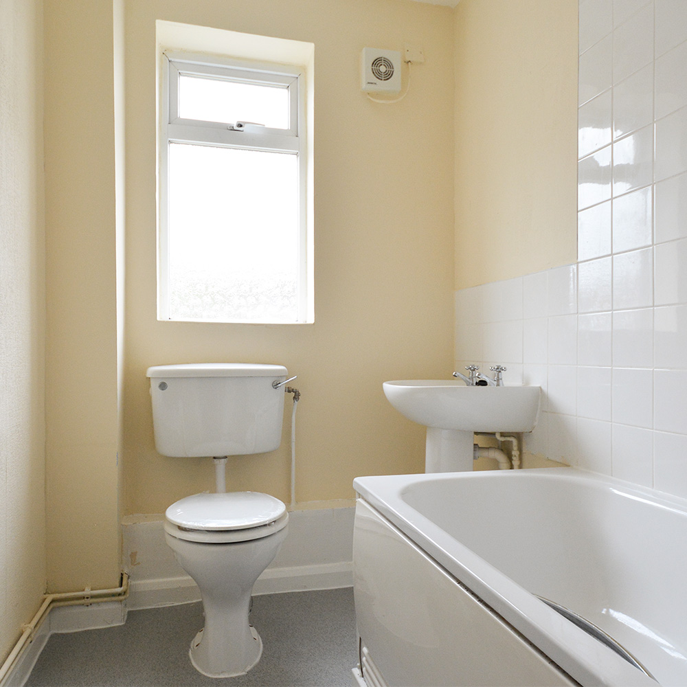 Bathroom including toilet and plumbing maintenance in a void property