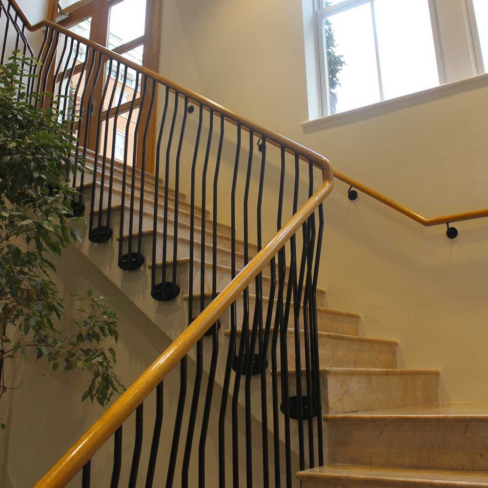Wooden staircase inside a grade two listed residential building restoration in Chelsea London