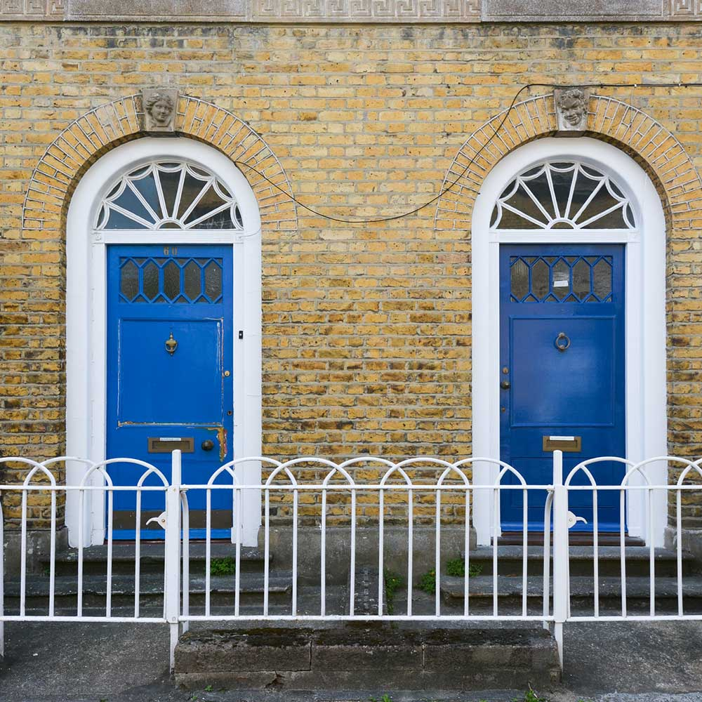 Two blue doors one before decoration and one after the painting and decorating works were carried out.