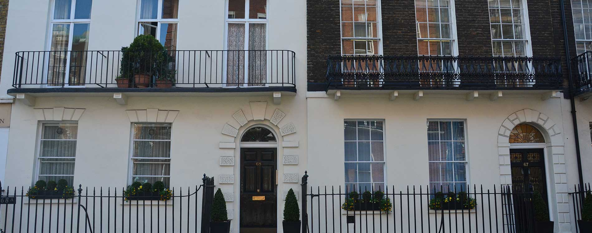Balcony's and doors at the front of a London home restored by axis