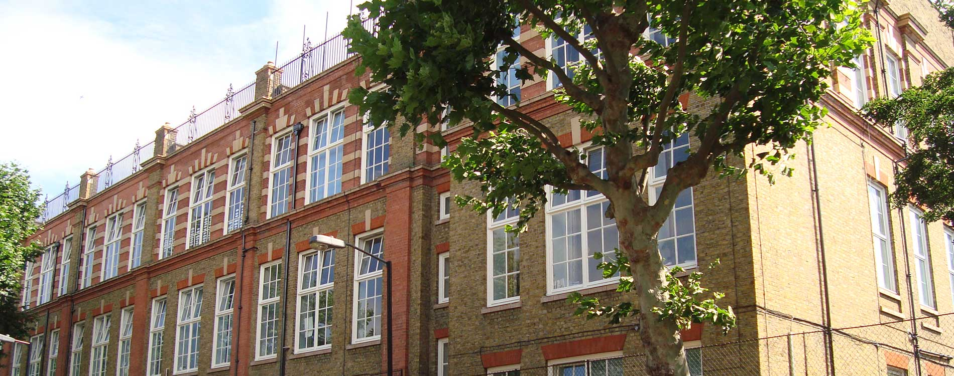 Historic london school with playground on the roof looks rejuvenated after the renovation works carried out by Axis