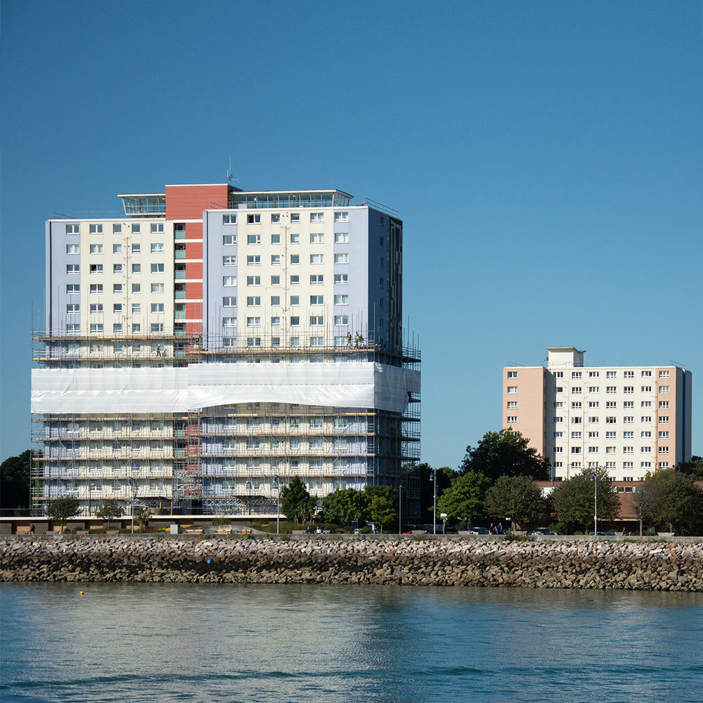 Gosport towers on a sunny day covered with scaffolding for cladding replacement