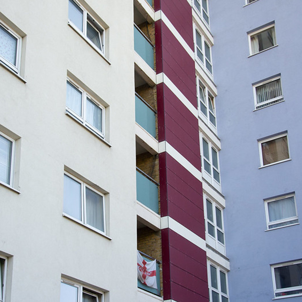 Windows and cladding on the side of a tower block
