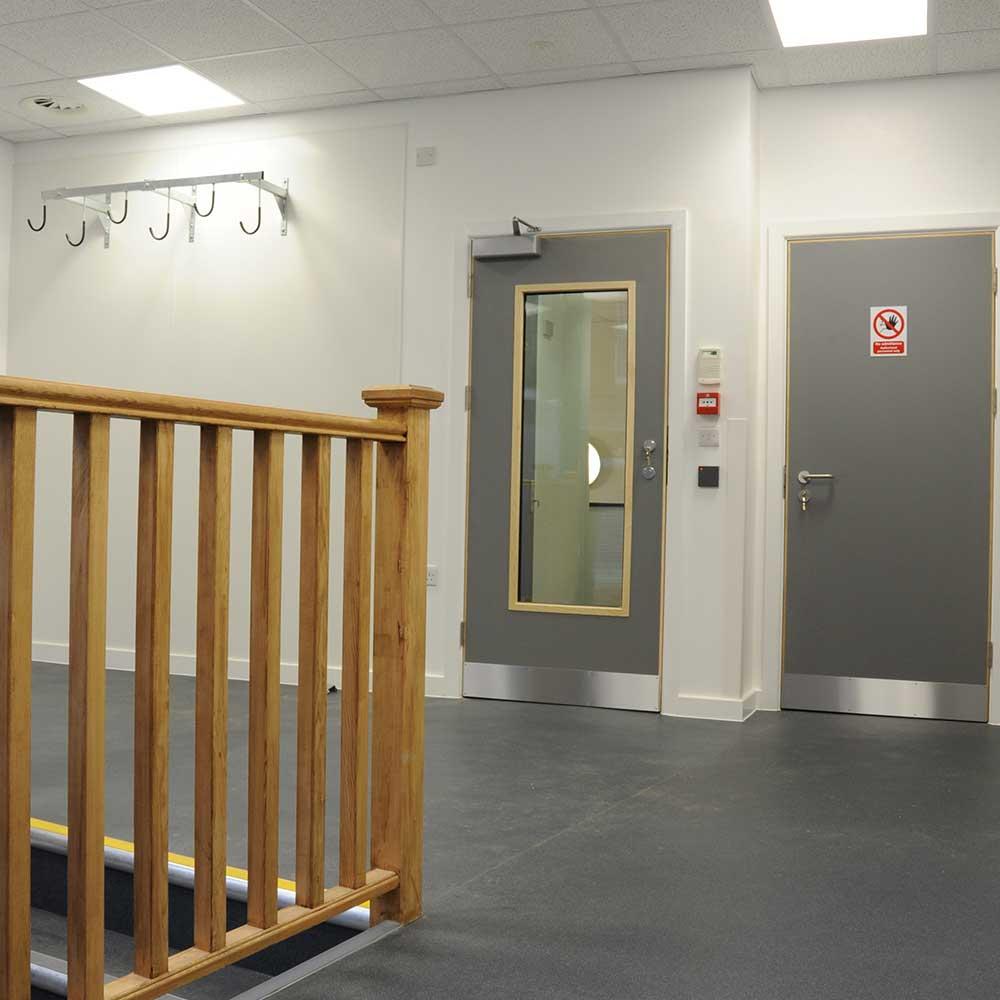 Hallway with door in Met refurbishment