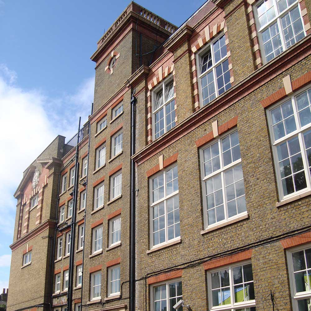 Old School with windows and red brickwork looking fres and new after an Axis Europe renovation project