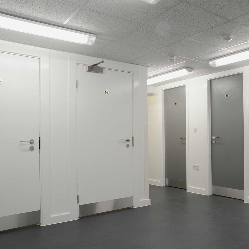 Corridor with door installation inside a police building project