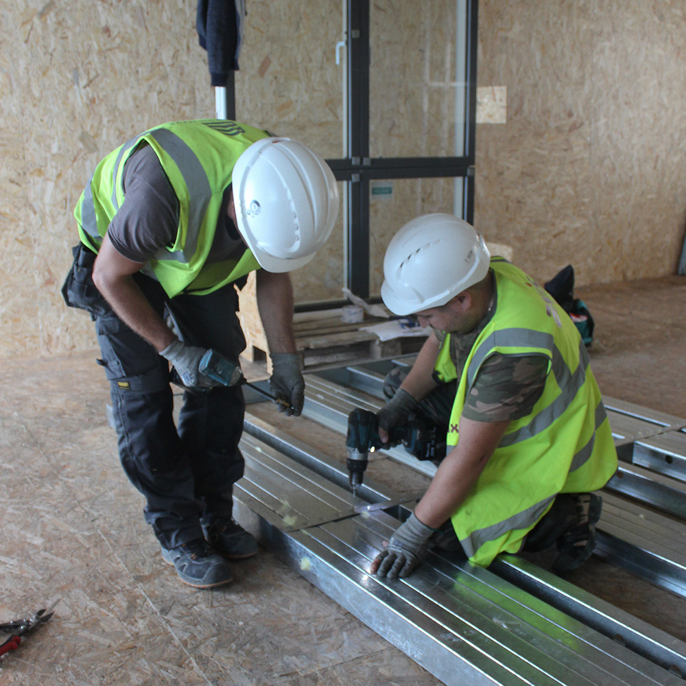 Axis subcontractors working on a job on site