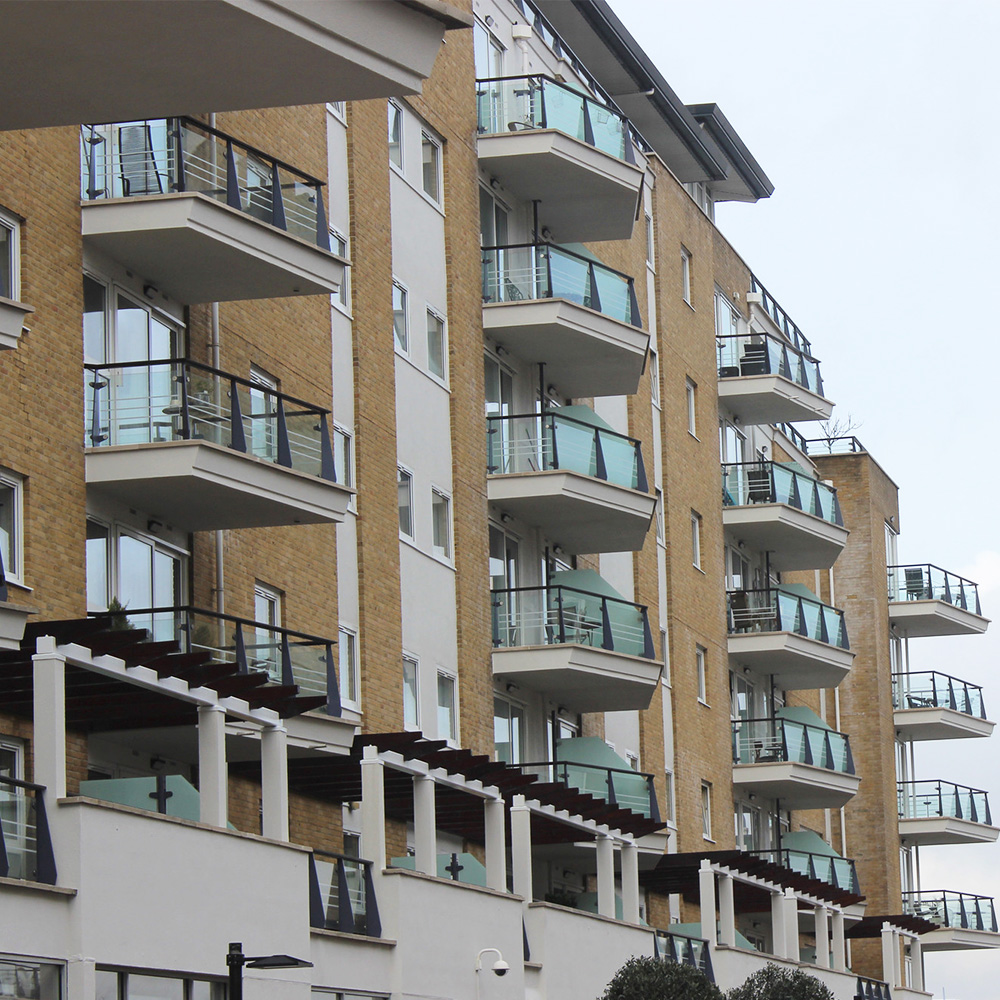 Large private housing block with new balcony glass, painting and decorating and doff cleaning applied by axis.