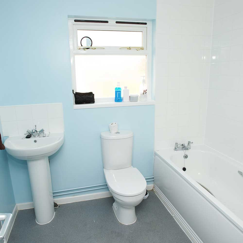 Blue and white new bathroom installed as part of home extension project