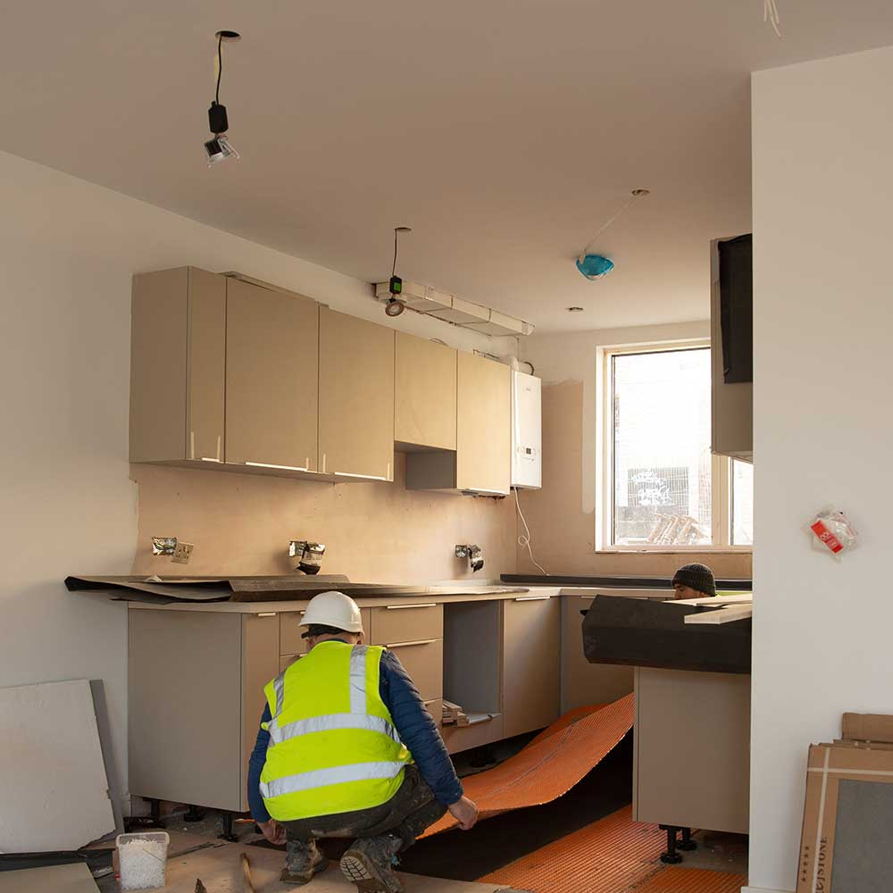 Axis operative installing a kitchen in a new build property
