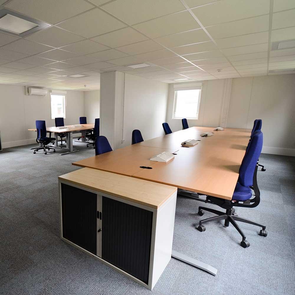 Desks set up inside a modular building