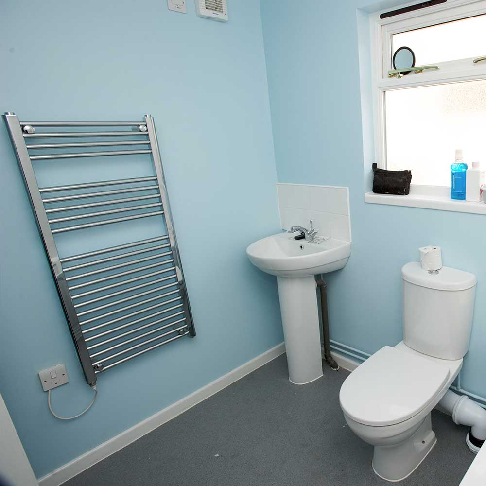 interior of a bathroom that has been installed by axis
