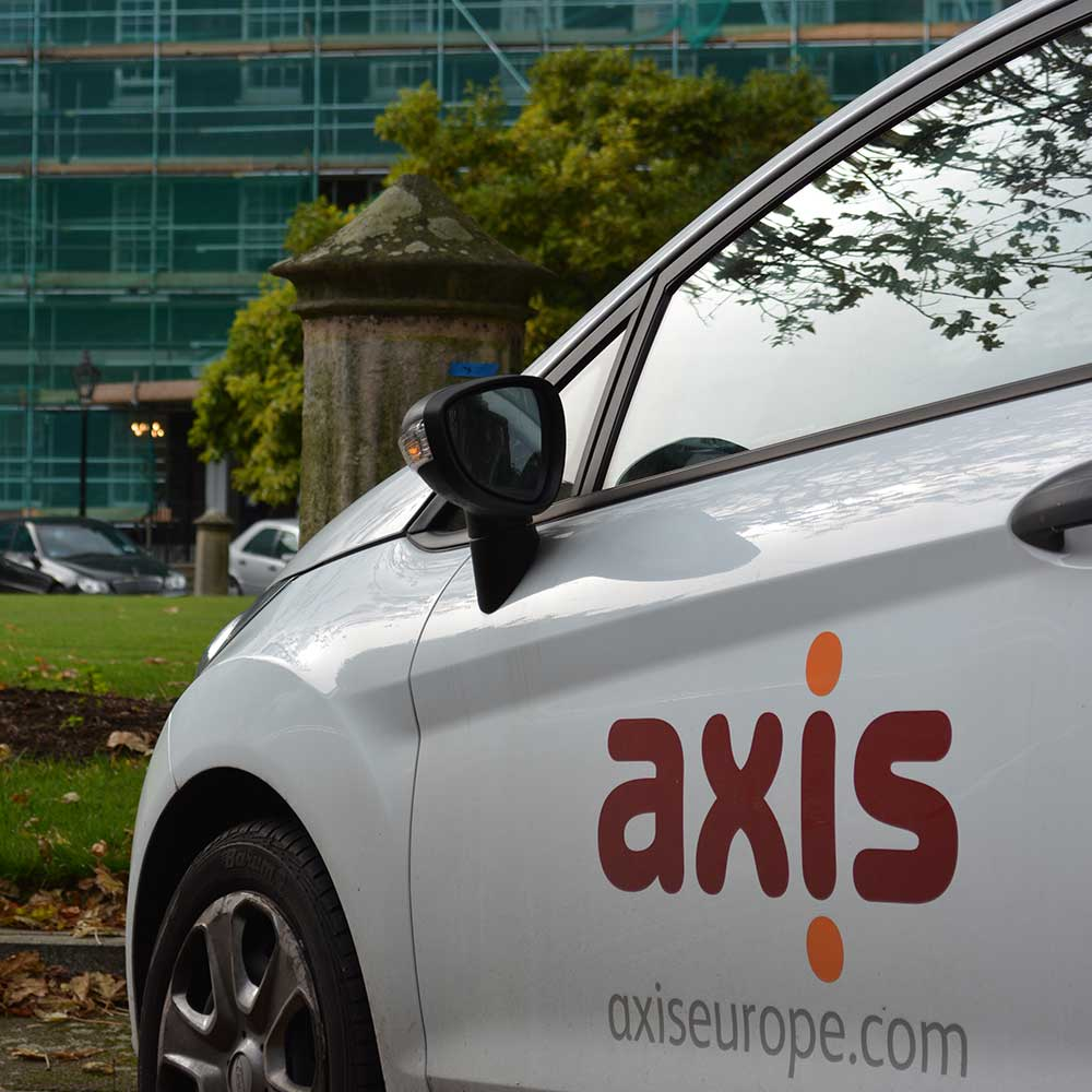 Axis car outside a heritage property