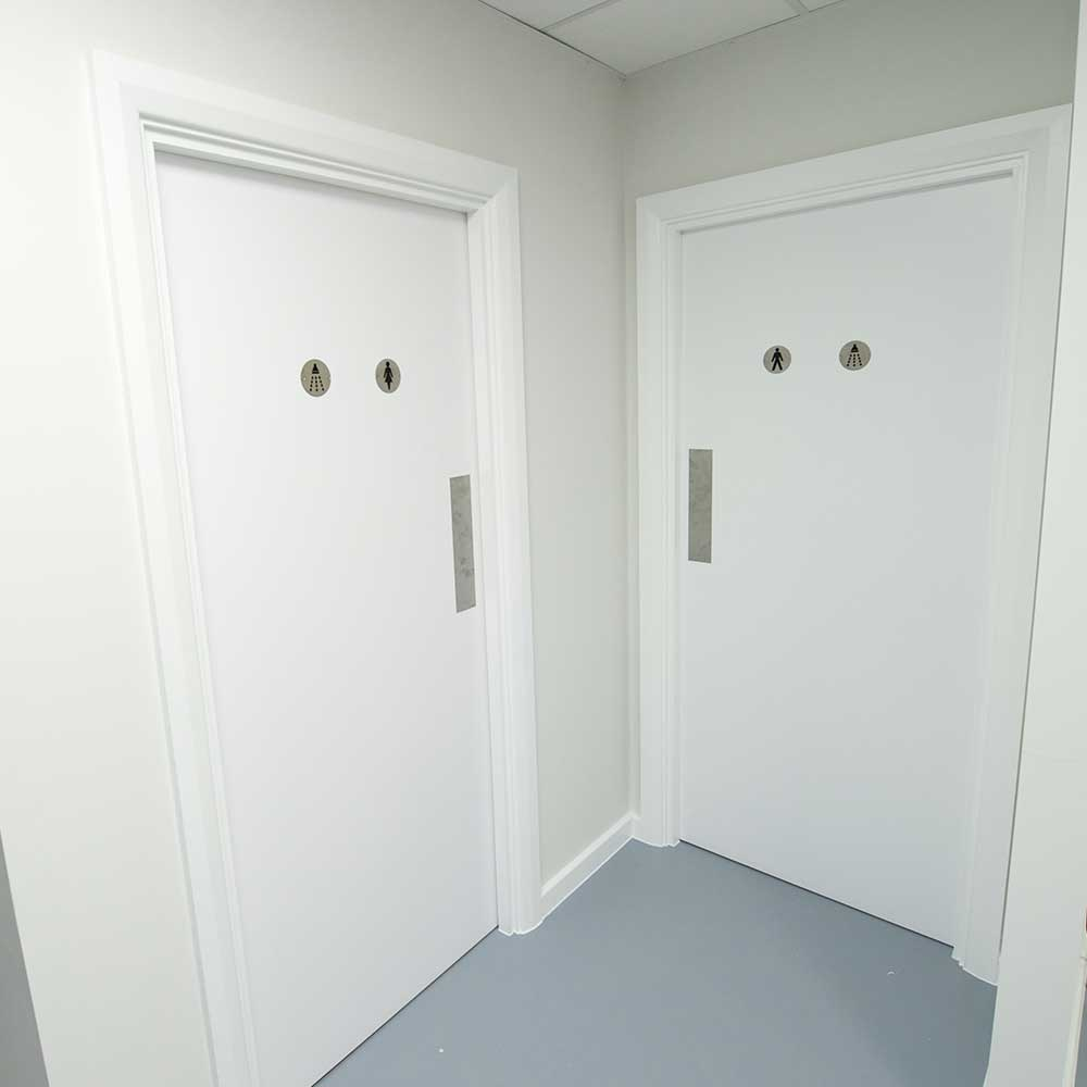 New fitted white bathroom doors inside a Met police renovation project