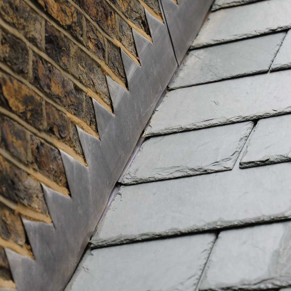 New slate roofing and lead flashing on the roof of a heritage building