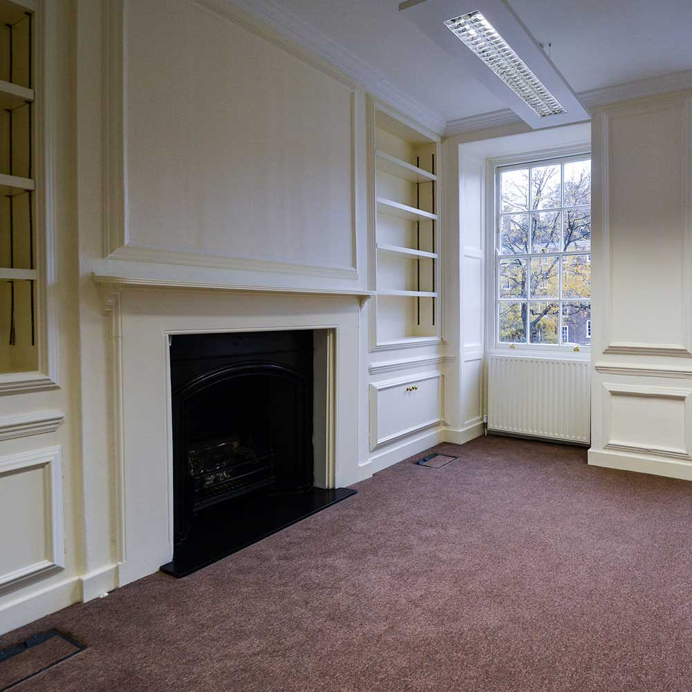 Large open carpeted room inside a heritage void property refurbishment