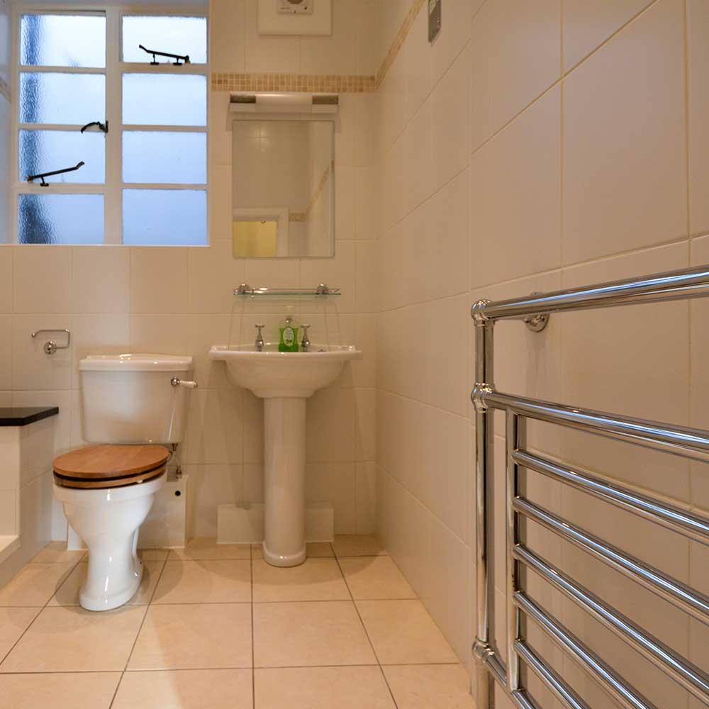 Bathroom with a radiator and toilet inside a high end property