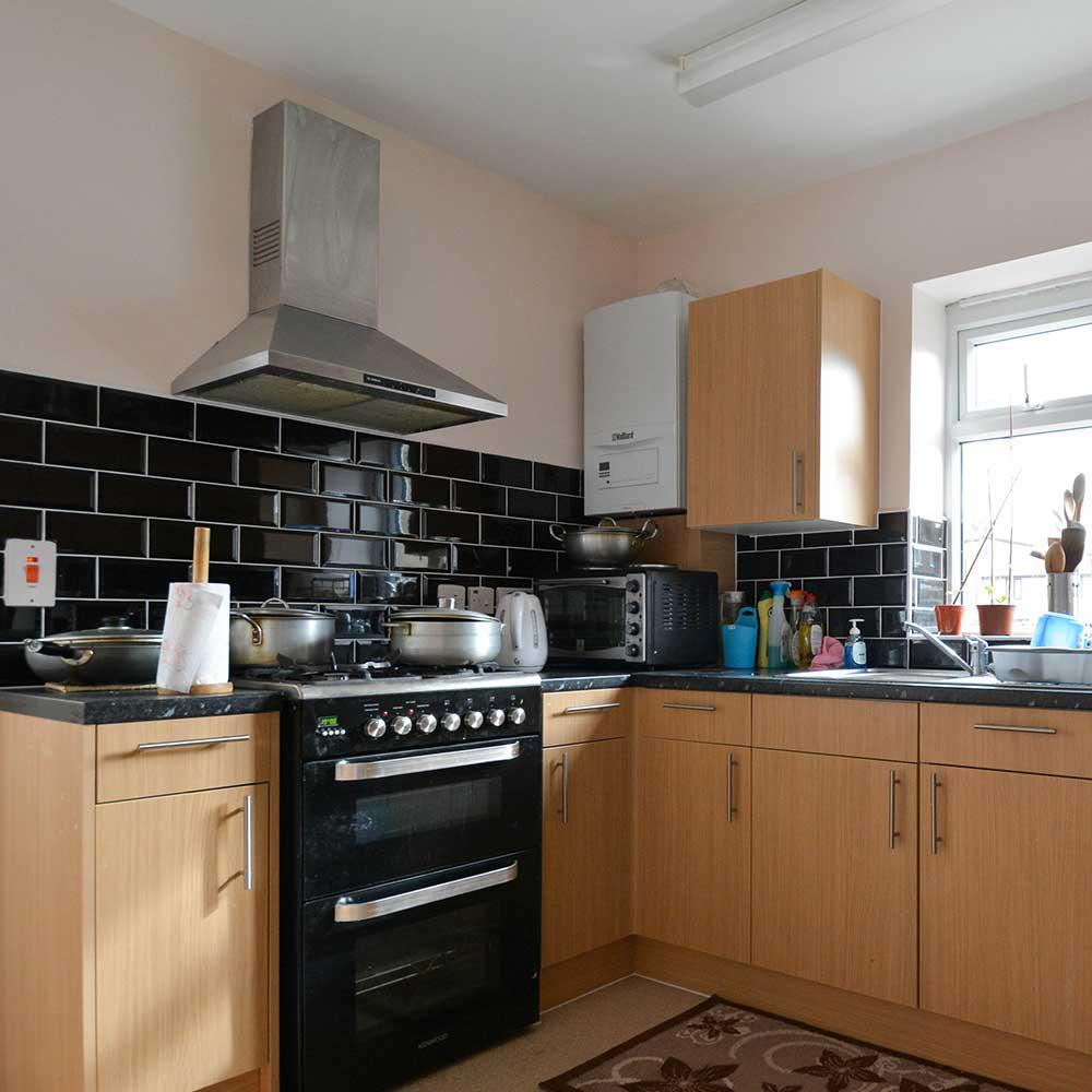 Kitchen inside a bespoke housing extension