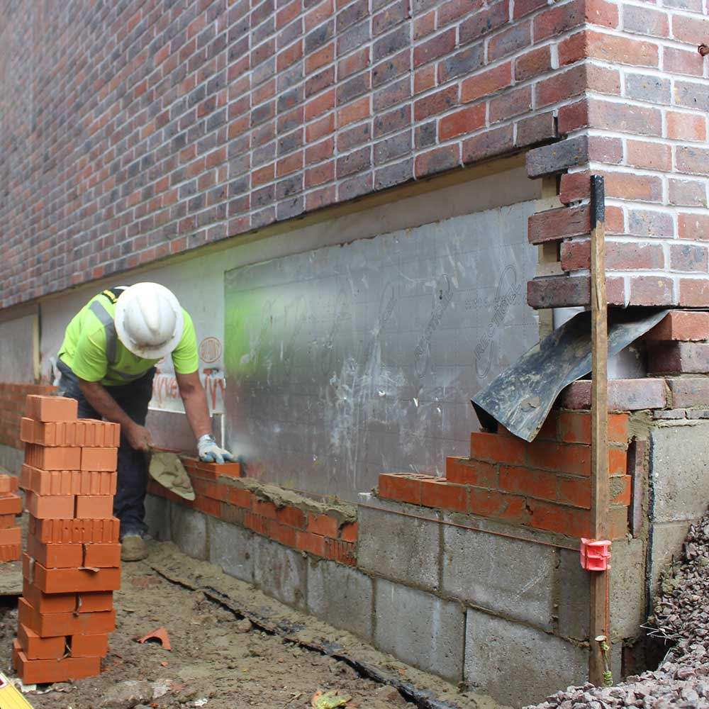 Brickwork taking place on the exterior of a new build home