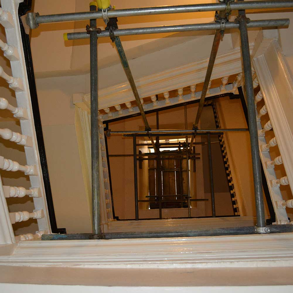 large structural scaffold holding a staircase inside a heritage property while works are being carried out