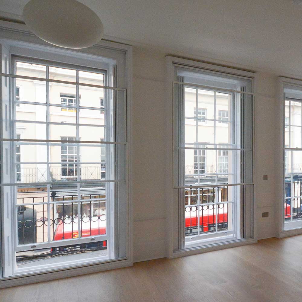 Three large windows inside an office conversion project
