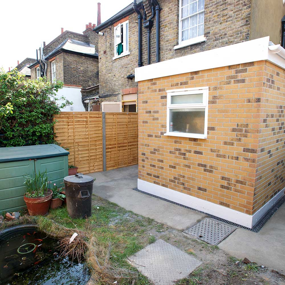 Garden with a pond and new bathroom extension