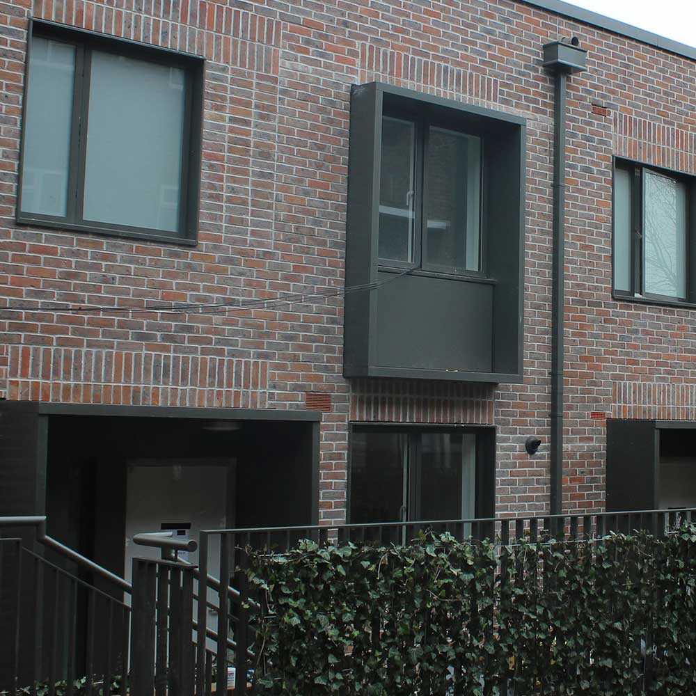 New build property with large windows and painted railings