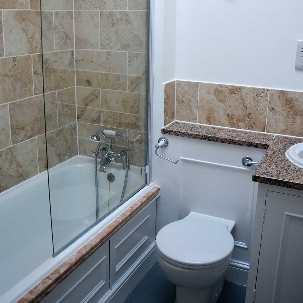 Bathroom inside a grade listed building where axis carried out works