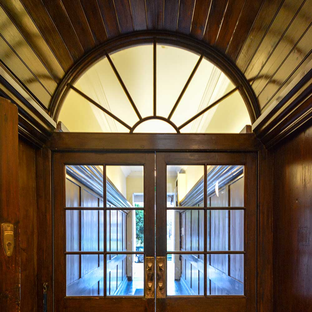 Grand wooden entrance doorway into a heritage property