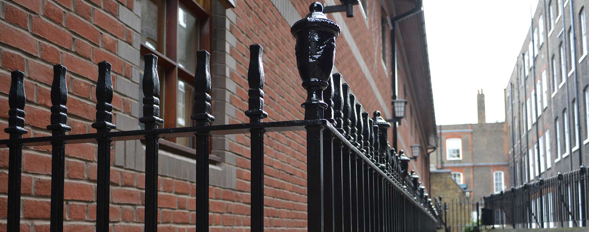 Repainted metal rail outside a heritage property