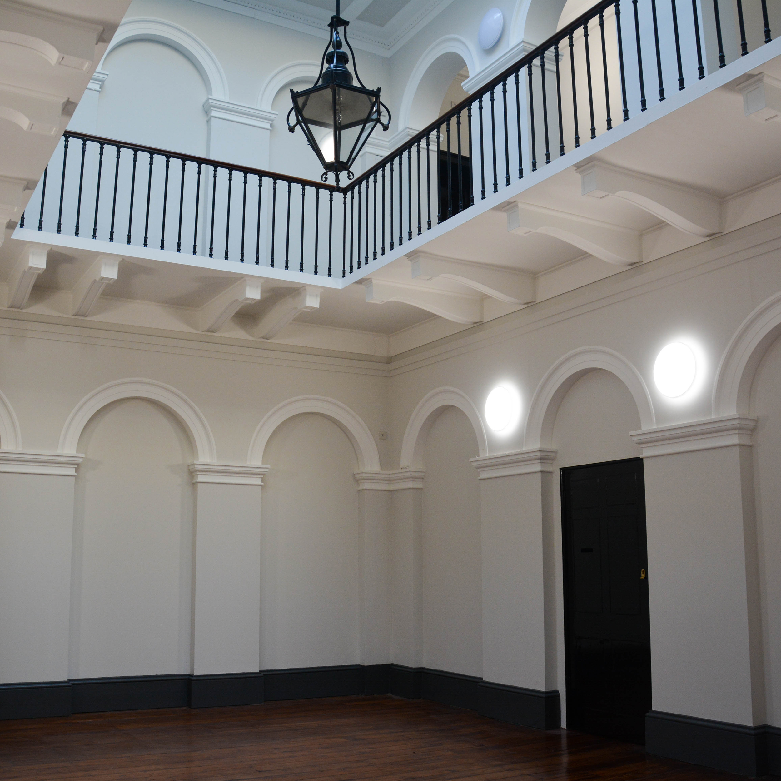 Large open hall inside a listed heritage building after repairs