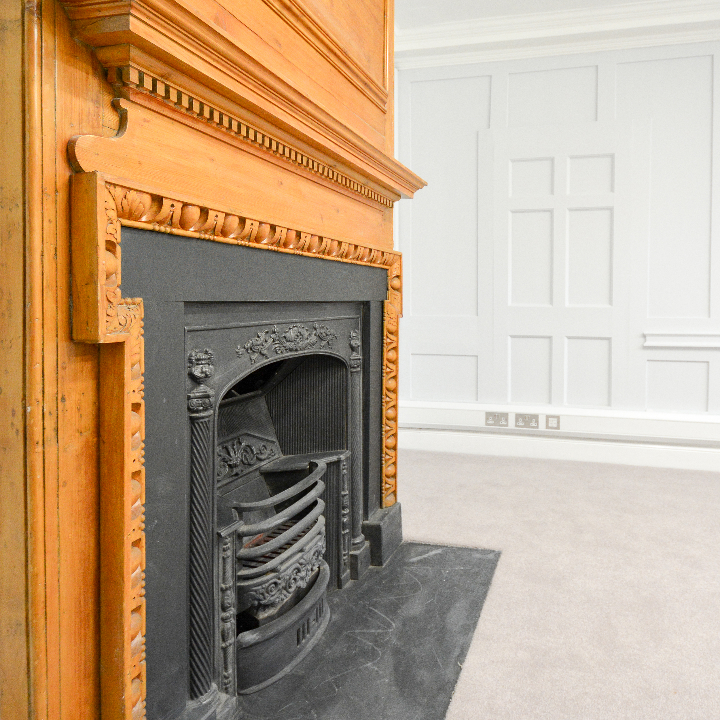 Fireplace inside a void heritage project