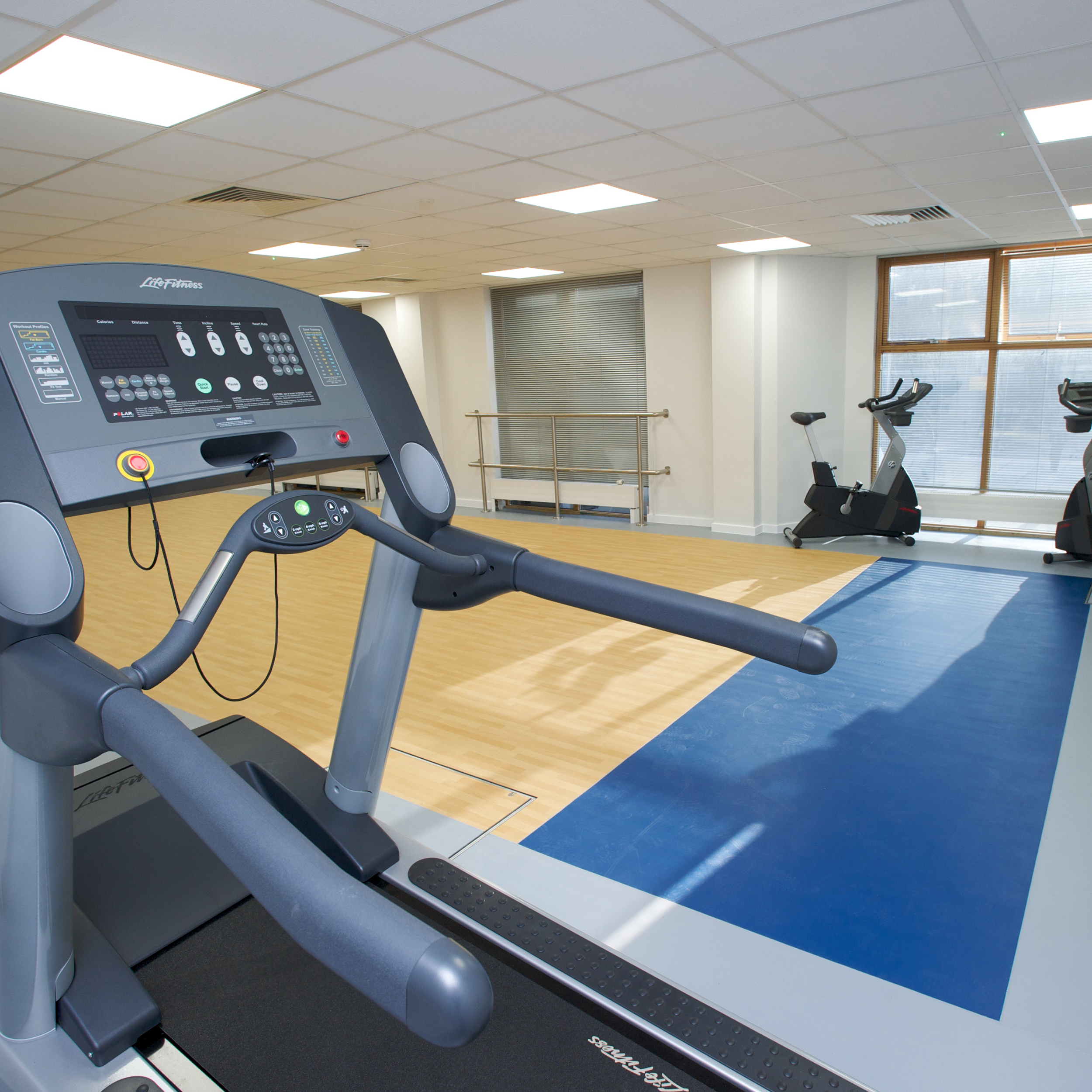 Treadmill and stationary bicycles inside a metropolitan police renovation project