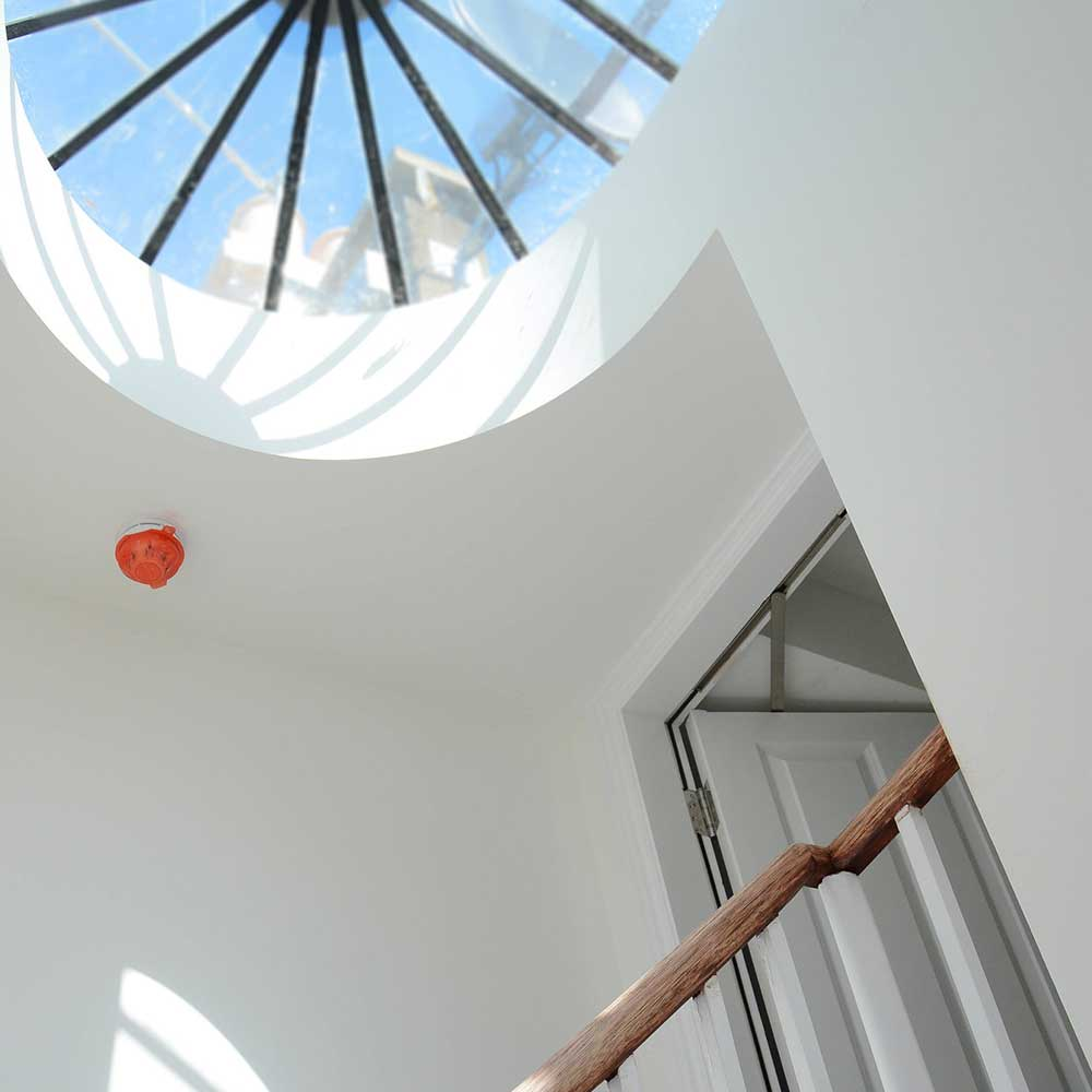Large skylight and staircase inside an office building conversion