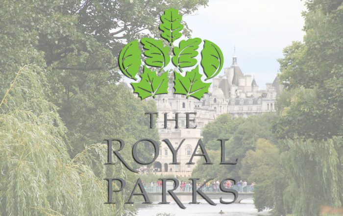 New framework with the royal parks shows the logo and a royal park on a summers day.