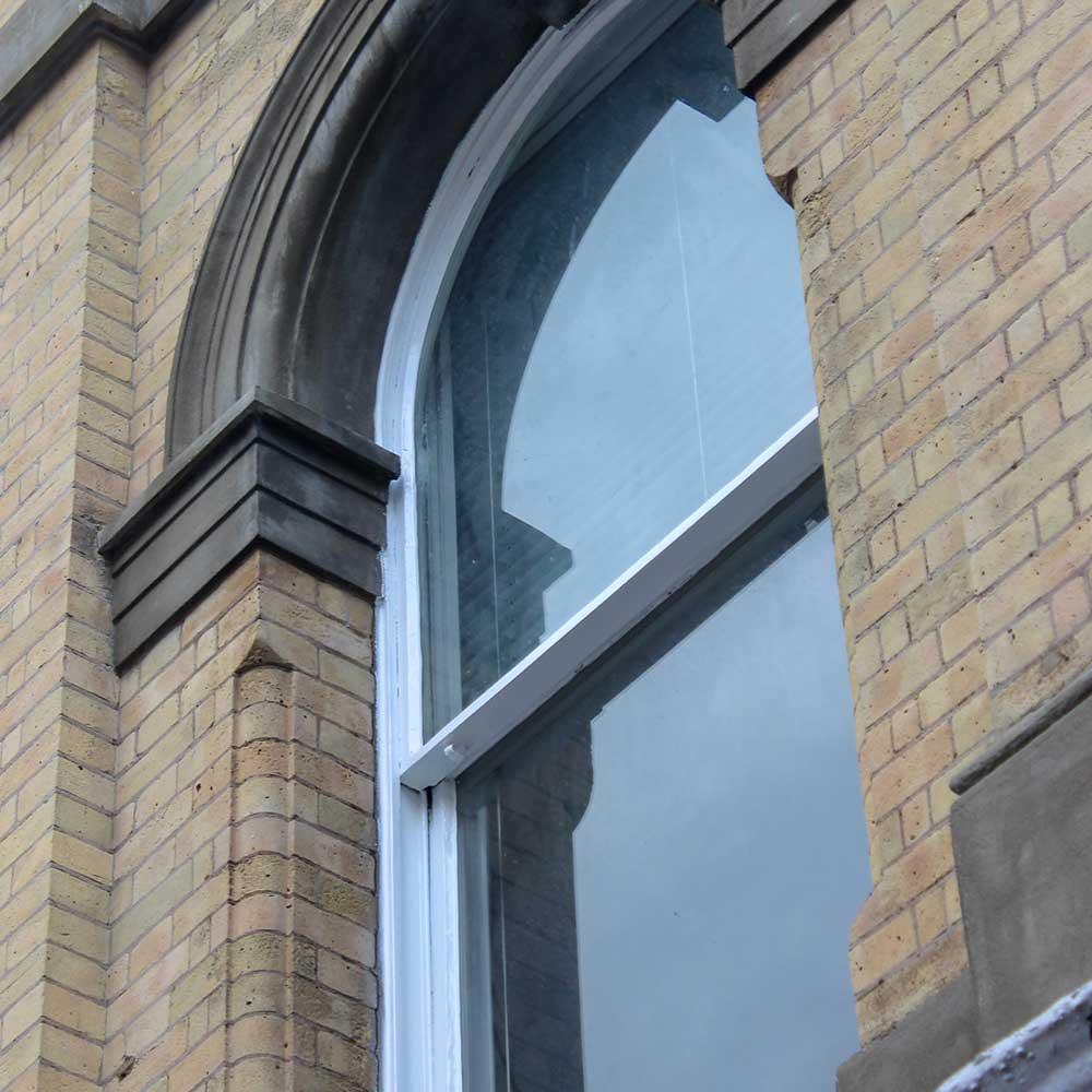 Window showcasing exterior renovations