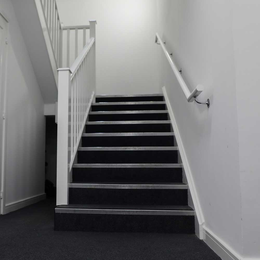 Minor repairs contract involving new carpeting and staircase decoration