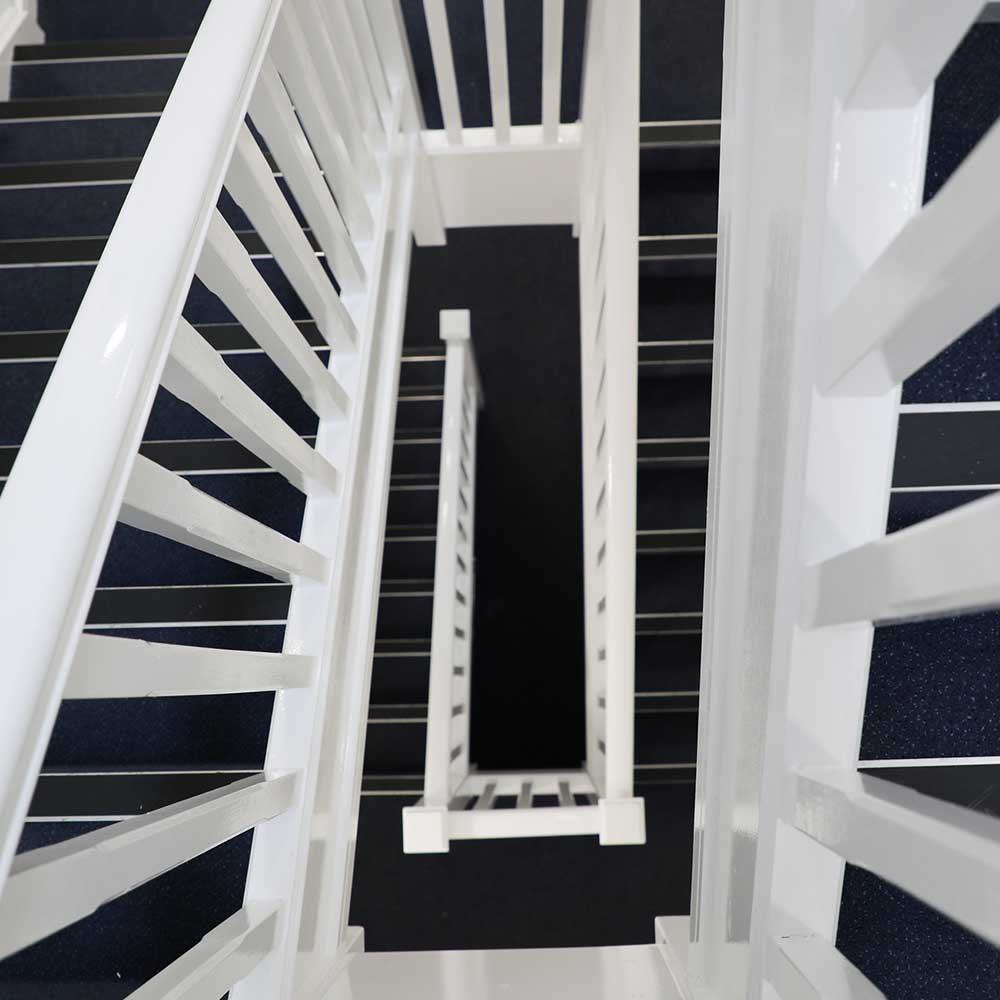 Large staircase inside a residential block freshly paint and new carpets by Axis as part of a minor repairs contract