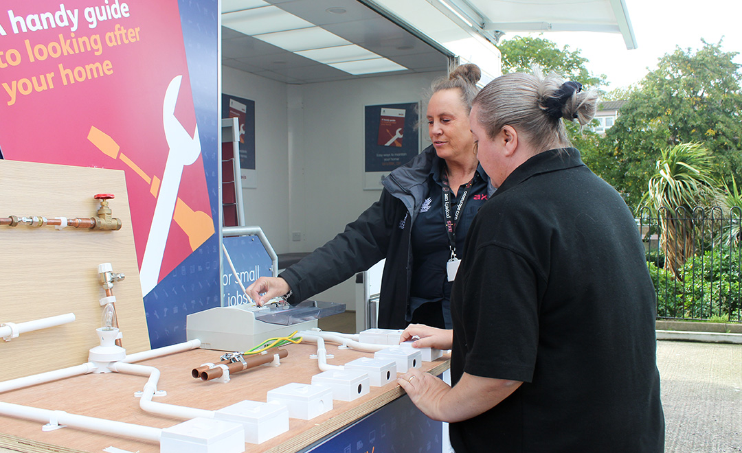 Axis team teaching residents home improvements from mobile DIY bus