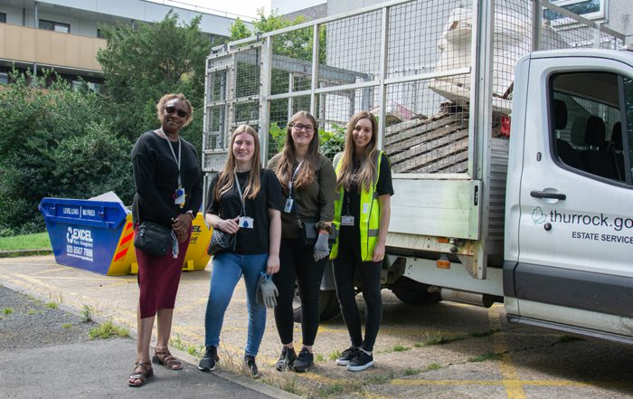 Volunteers with the skip and the caged van were residents disposed of waste sustainably
