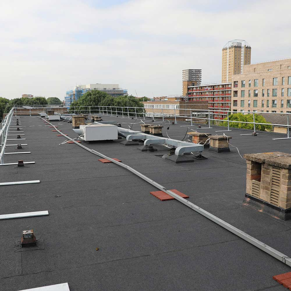 Flat roof that with a London skyline backdrop after a recent refurbishment